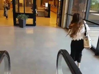 Cute asian girl with remote vibe outside